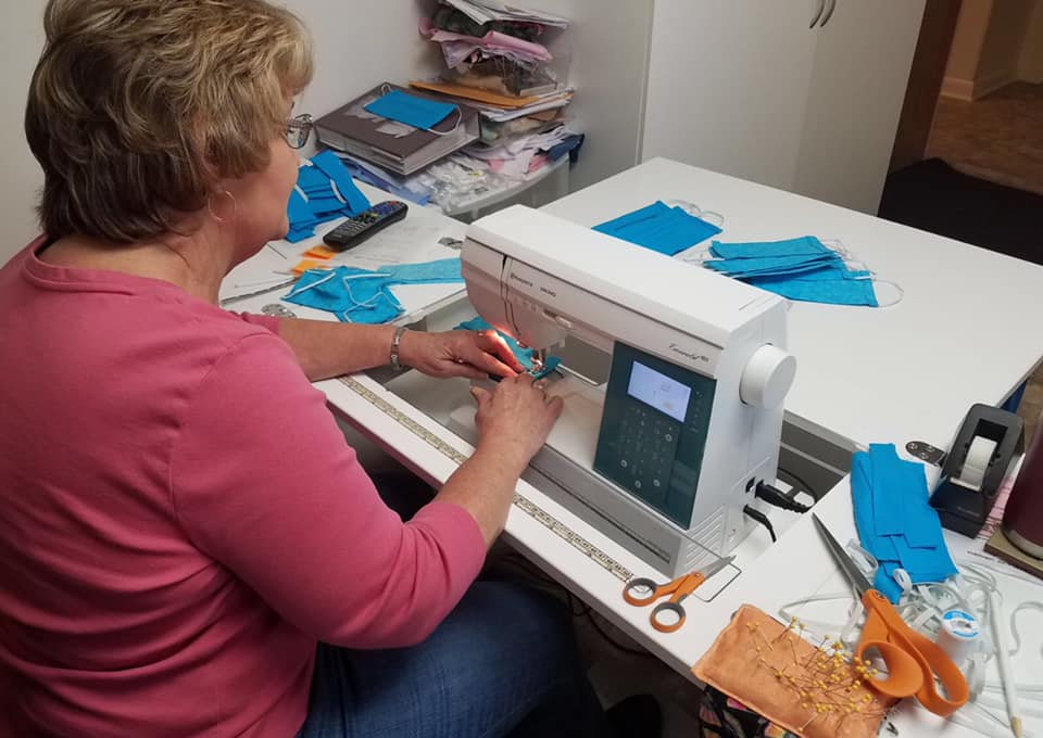 Cheryl Gregory sews masks for hospice workers