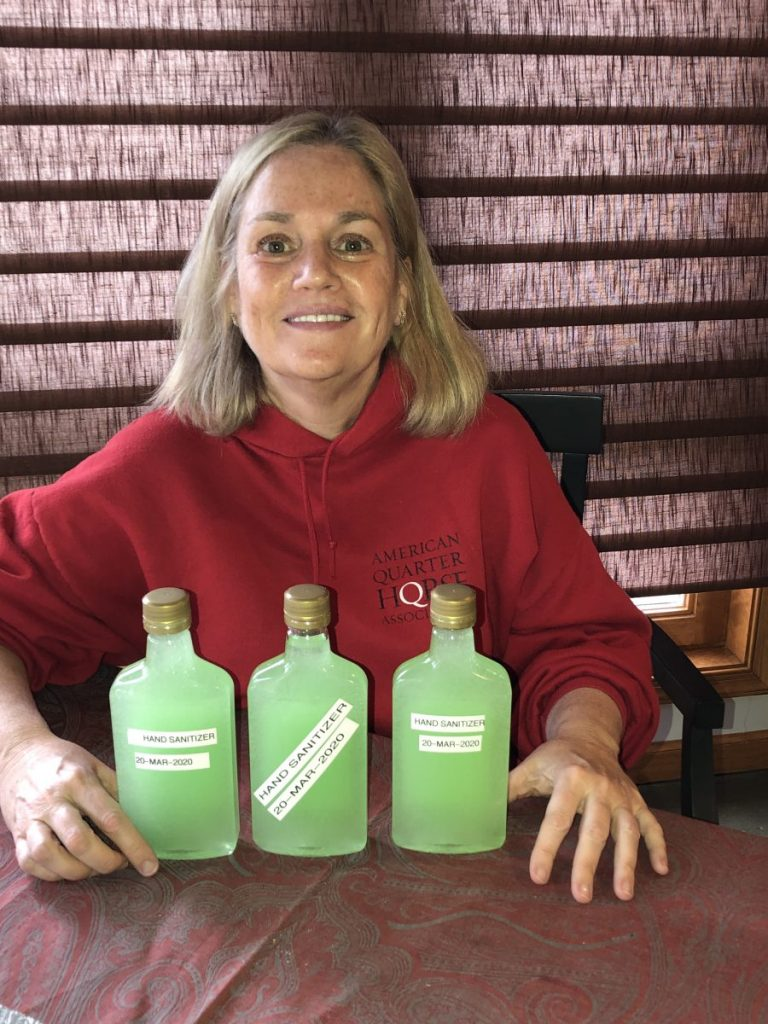 Lisa Darsch with the hand sanitizer she made for the Morgan County Health Department.