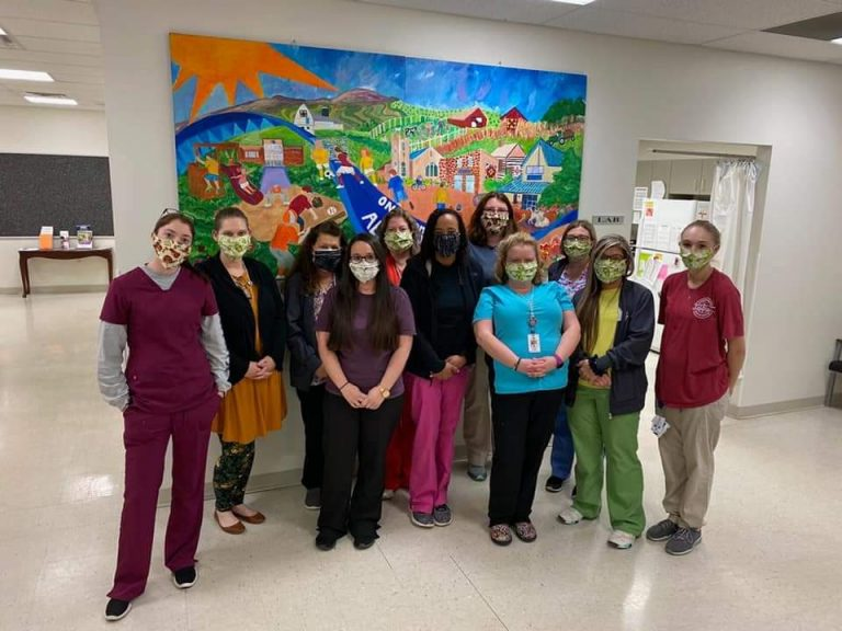 Tri-State Health Center staff wear donated fabric masks. They have said they need more.